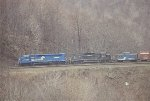 CR SDP45 6680 and SD40 6277 help ease boxcars down the hill
