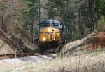 CSX ES40DC 5445 emerges from the woods