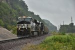 NS 8011 Crawls in the rain with a loaded BNSF coal drag.