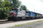RLCX 8547 leads a colorful consist through Fostoria