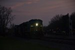CSX 7678 leads east in the fading light.