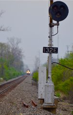 CSX intermodal approaches veteran New York Central target signals at Cooke Road.
