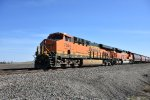 BNSF 7044 Drags a westbound grain load toward Wellsville ks.