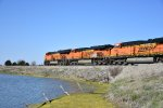 BNSF 3993 Race's west with a Z train in tow.