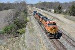 BNSF 7682 Leads a rock train East.