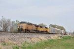 UP 7437 Leads a WB rack train toward Topeka KS.