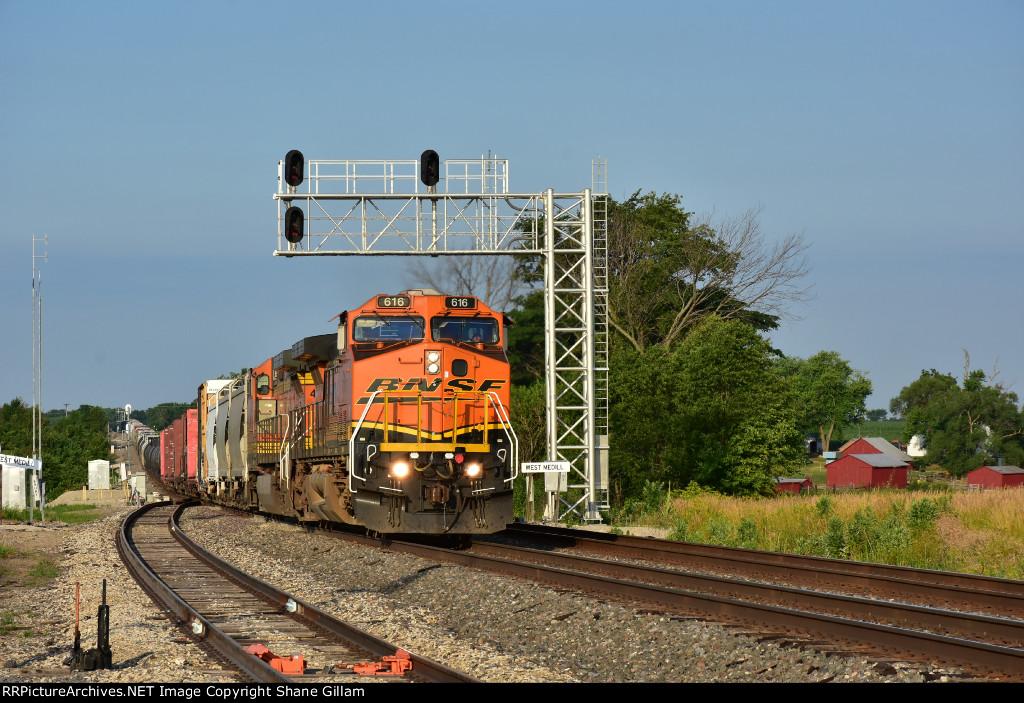 BNSF 616 Ex Santa Fe dash 9 leads a freight down the Marceline Sub.