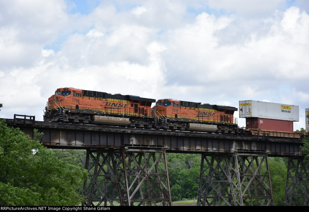 BNSF 7798 Works Dpu on a eastbound stack over Media Trestle.