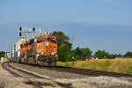 BNSF 6566 Races east with a stack train in tow.