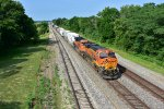 BNSF 8335 Leads a freight down hill into Medill Mo.