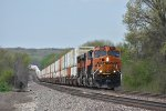 BNSF 3953 Races up hill with a Q train in tow.