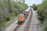BNSF 5780 Slow's to a crawl up hill at Revere Mo.
