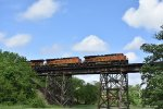 BNSF 6630 Races over the Media IL trestle.