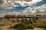 WB stacks cross old SP bridge near the Salton Sea.