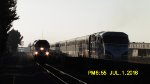 A northbound Surfliner train and a southbound Metrolink train meet