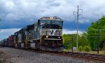 Long NS freight on the uphill grade crossing from Columbus to Worthington, Ohio under incoming rain showers.