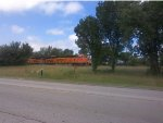 BNSF 7947 leads a DOD train.