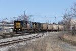 CSX 7515 slowly leads empty grain train V981-17 west through Sunnyside