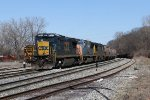 V981 rolls up to Plaster Creek with an empty grain train for Marquette Rail