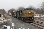 CSX 7674 leads Q326 east through Grandville