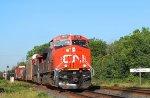 Eastbound #394 passes over the CN Carew diamond