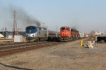 11G waits with CN power as Amtrak 354 passes