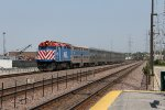 Metra 170 brings an outbound train up to the Berkeley station