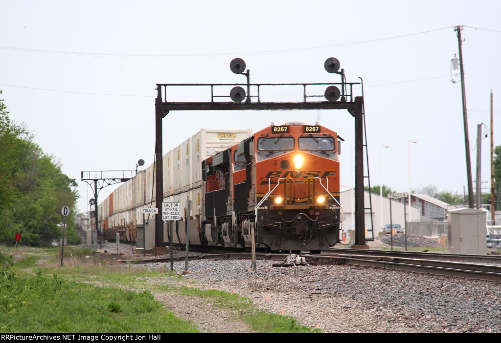 BNSF 8267 leads east under the old ATSF signals