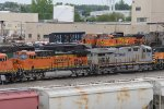 One of BNSF 's AC44C4M's sits with a CREX unit