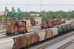 BNSF, CN & NS units, along with a new Farmrail engine, mingle around the Galesburg shops