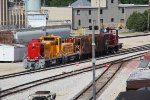 CIC 204 & 304 sit with some ballast cars and a private switcher