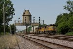 Eastbound stacks roll under the old coaling tower
