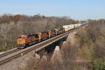 BNSF 7774 rolls across the bridge over the Vermilion River with the Z-WSPSTO9 in tow
