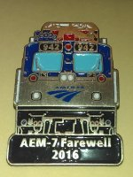 A souvenir lapel pin of the day's lead locomotive