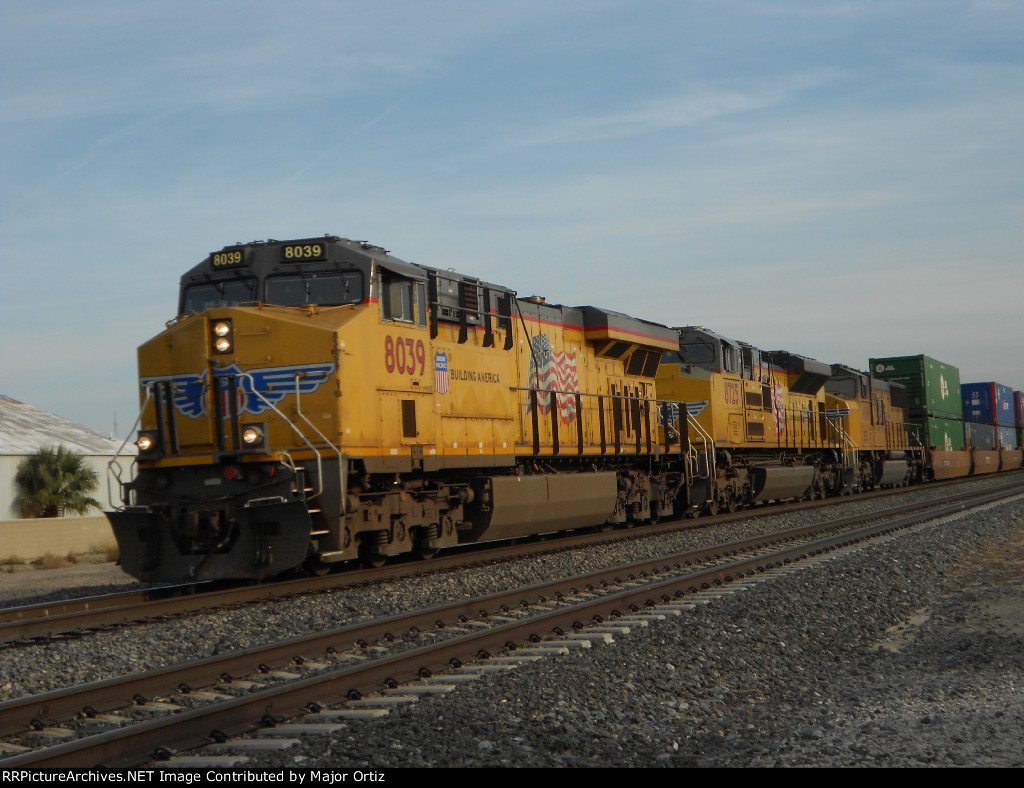 UP 8039 leads stack train through Lancaster