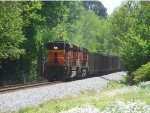 Two BNSF units shove hard on the rear of a loaded coal train