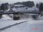 NS 2696 kicking up snow EB
