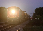 CN 8872's headlight cuts through the evening mist