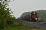 CSX 8808 Races east in the rain with a rock train in tow.
