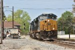CSX 3134 Heads up a eastbound mixed freight in Fostoria Ohio.