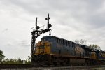 CSX 5284 Rolls under the ex C&O signals at Deshler Ohio.