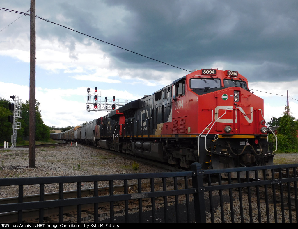 CN 3094 Charges East With A Developing Thunderstorm Overhead