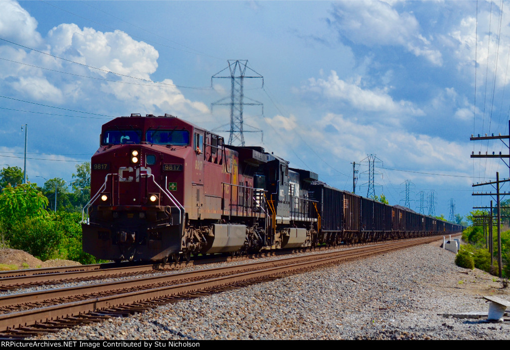 Grungy CP Rail union leads coal train northbound at Columbus.