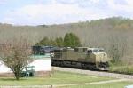 NS 710 passes a trailer park
