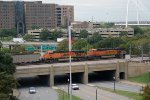 BNSF 5989, 6323 Push a full coal train over the grassy knoll, triple overpass at JFK Junction