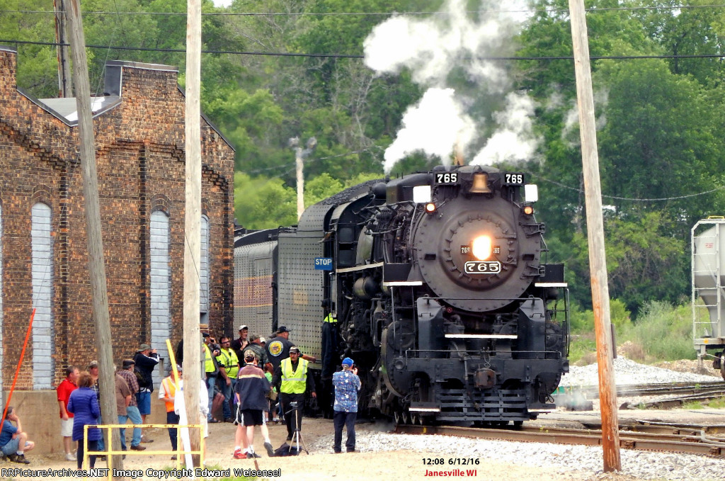 Excursion train pulls across Pearl St. and the roundhouse