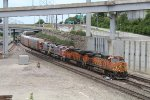 BNSF autorack w/ two Warbonnets in tow