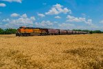 BNSF 7183 DPU on eastbound BNSF loaded grain train