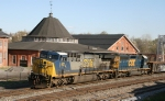 CSX 621 & 8021 lead train S410 past the station & old roundhouse