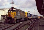 CSX 2645 and other locos are tied down on a train in the yard